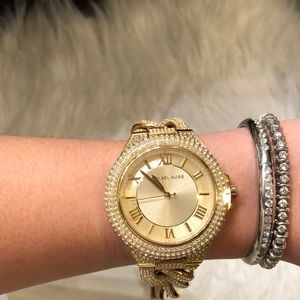 Michael Kors Accessories - GENTLY USED MICHAEL KORS GOLD WATCH